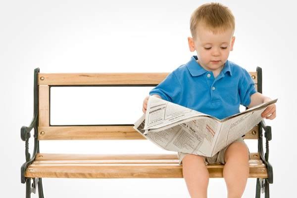 child reading newsletter